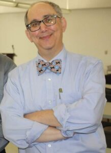 Lawrence with his blue shirt and bowtie